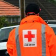 Red Cross volunteer - Stock Photo