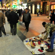 African street hawker in Madrid Spain - Stock Photo
