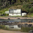 Remote batch holiday house in rural New Zealand - Stock Photo