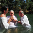 Baptism ceremony at the Jordan River - Stock Photo