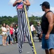 Womwalk on stilts — Stock Photo #23939503