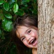 Stock Photo: Girl play hide and seek