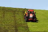 Tractor plowing the ground — Stock Photo