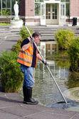 Swimming pool service technician — Stock Photo