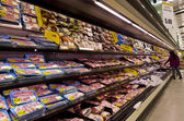 Meat on shelves in supermarket — Stock Photo