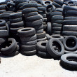 Stock Photo: Pile of used rubber tyres