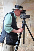Travel photographer at work — Stock Photo