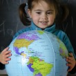 Girl holds a globe — Stock Photo