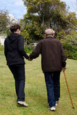 Assisting and helping elderly people — Stock Photo