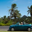 Young woman traveling by convertible car in a Pacific Island — Stock Photo #33040021