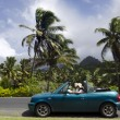 Couple traveling by convertible car in a Pacific Island — Stock Photo #33194035