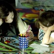 Mother and her daughter drawing together — Stok fotoğraf