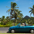 Couple travel by car in Tropical Island — Stock Photo #33935615