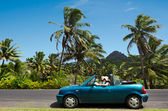 Couple travel by car in Tropical Island — Stock Photo