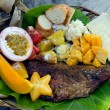 Tropical food dish in Aitutaki Lagoon Cook Islands — Stock Photo
