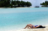 Young woman sunbathing in Aitutaki Lagoon Cook Islands — Stock Photo