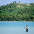 Stock Photo: Casting for bonefish in Aitutaki Lagoon Cook Islands