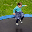 Girl jumps on trampoline — Stock Photo #34917905