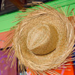 Straw hats for sale in a tropical souvenir shop — Stock Photo
