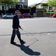 Blind mwalks with cane in street — Stock Photo #35085455