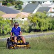 Stock Photo: Man ride on lawn mower