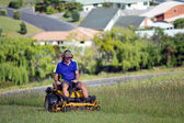 Man ride on lawn mower — Stock Photo