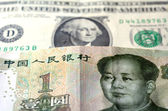 Chinese Yuan on American Dollar — Stock Photo