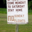 No Sunday Flights protesting sign in Aitutaki Lagoon Cook Island — Stock Photo