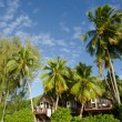 Beach bungalow in tropical pacific ocean Island. — Stock Photo