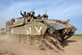 Israeli soldiers on armed vehicle — Stock Photo