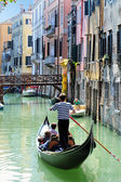 Venice Cityscape - Gondolier rowing gondola — Stock Photo