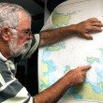 Sailor reads a sea map — Stock Photo #37847307