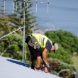 Stock Photo: Roofer fixing a roof