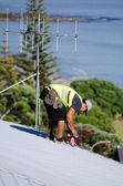 Roofer fixing a roof — Stock Photo