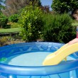 Child in children inflatable pool — 图库照片