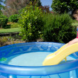 Child in children inflatable pool — Stok fotoğraf