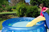 Child in children inflatable pool — Stock Photo