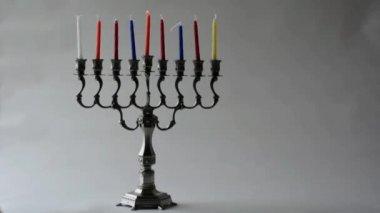 Jewish woman lit Hanukkah menorah — Stock Video