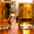 Stock Photo: Mugs of beer