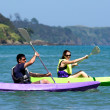 Stock Photo: Couple kayaking at sea