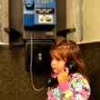 Child talks on pay phone — Stock Photo #40563483