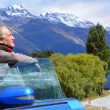 Stock Photo: Mature mtravel by car