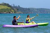 Couple kayaking at sea — Stock Photo