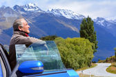 Mature man travel by car — Stock Photo