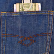 Stock Photo: Money in back pocket of jeans