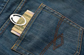 Money in the back pocket of jeans  — Stock Photo