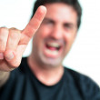 Mature man showing the devil thorns gesture sign — Stock Photo