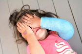 Abused little girl with a broken arm — Stock Photo