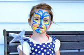 Kind gezicht schilderen — Stockfoto
