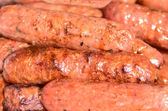 Sausages background texture — Stock Photo